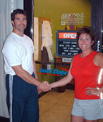 Health club owner shaking hands with an Amerishape Sales Promotion Representative